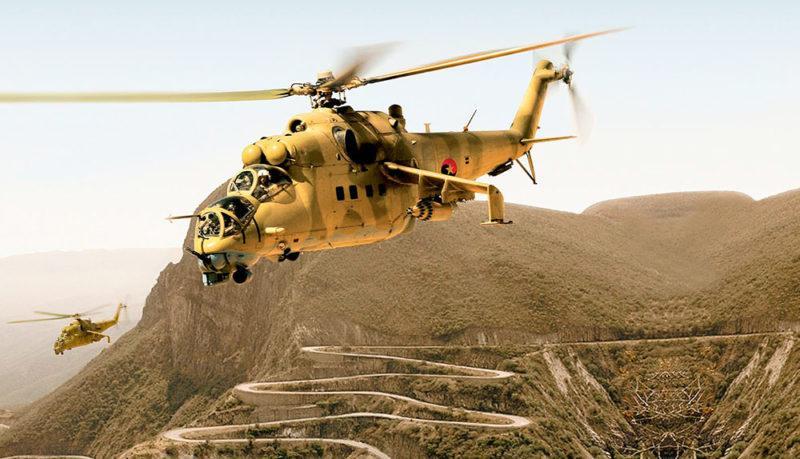 Ангольские вертолеты советского производства Ми-24 над горой Серра де Леба. Ангола, дорога Лубанго-Намиб. Дорога в виде серпантина, спускающаяся с горы Серра де Леба – один из символов Анголы.